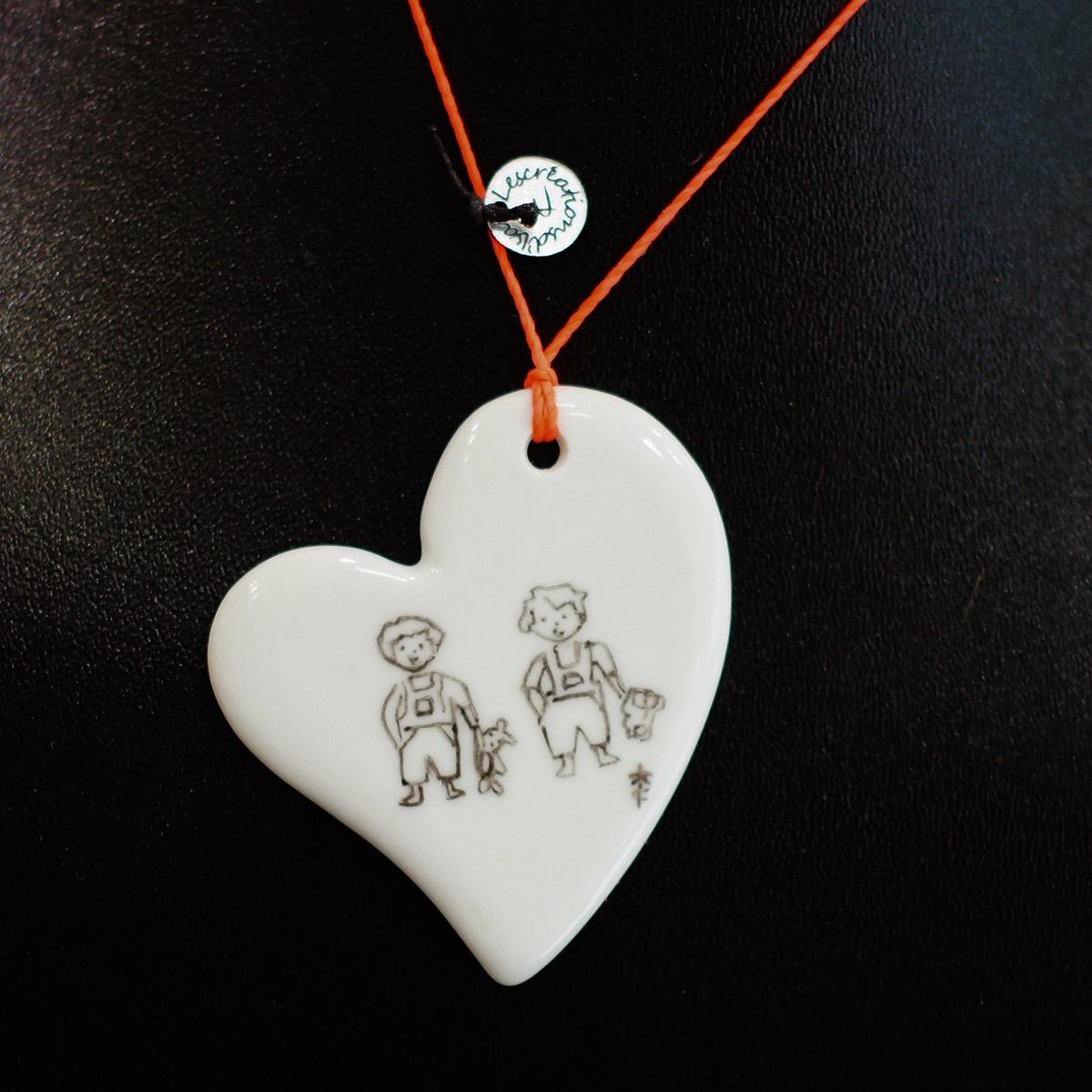 pendentif-coeur-figurines-gars