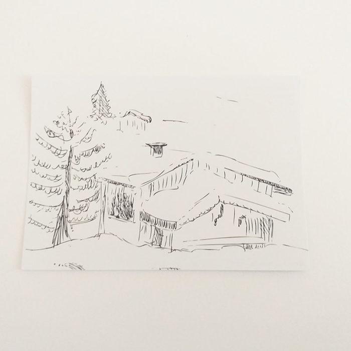 Verso de la carte postale, noir et blanc. Chalet enneigé